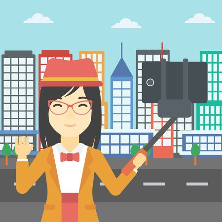 woman cellphone: An asian woman making selfie with a selfie-stick. An asian woman taking photo with cellphone and waving on a city background. Vector flat design illustration. Square layout.