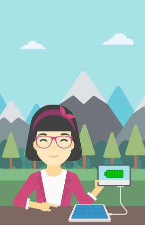 woman tablet: An asian woman charging tablet computer with solar panel on a background of mountains. Charging digital tablet from portable solar panel. Vector flat design illustration. Vertical layout. Illustration