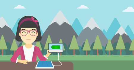woman tablet: An asian woman charging tablet computer with solar panel on a background of mountains. Charging digital tablet from portable solar panel. Vector flat design illustration. Horizontal layout.