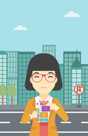 An asian woman holding modular phone. Woman with modular phone standing on a city background. Woman using modular phone. Vector flat design illustration. Vertical layout.