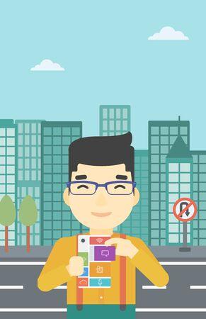 An asian man holding modular phone. Young man with modular phone on a city background. Man using modular phone. Vector flat design illustration. Vertical layout.