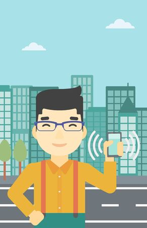 ringing: An asian man holding ringing mobile phone on a city background. Man answering a phone call. Man with ringing phone in hand. Vector flat design illustration. Vertical layout. Illustration