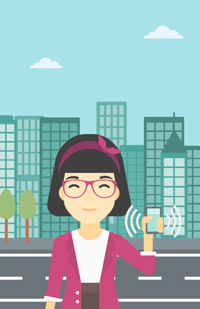 ringing: An asian woman holding ringing mobile phone on a city background. Woman answering a phone call. Woman with ringing phone in hand. Vector flat design illustration. Vertical layout.