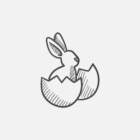 sweetmeats: Easter bunny sitting in egg shell sketch icon for web, mobile and infographics. Hand drawn vector isolated icon. Illustration