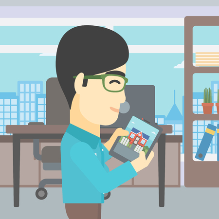looking at computer screen: An asian man looking at house on a digital tablet screen. Young man standing in office and looking for house on tablet computer. Vector flat design illustration. Square layout.