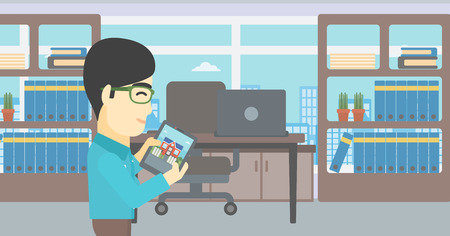 looking at computer screen: An asian man looking at house on a digital tablet screen. Young man standing in office and looking for house on tablet computer. Vector flat design illustration. Horizontal layout. Illustration