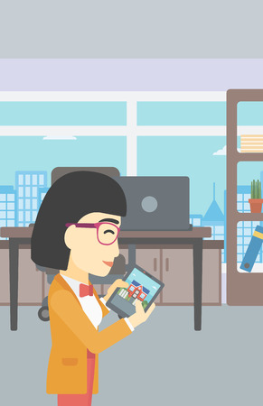looking at computer: An asian woman looking at house on a digital tablet screen. Young woman standing in office and looking for house on tablet computer. Vector flat design illustration. Vertical layout.