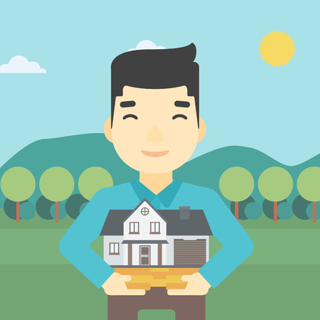 An asian young man holding house model in hands on the background of mountains. Real estate agent with house model. Vector flat design illustration. Square layout.