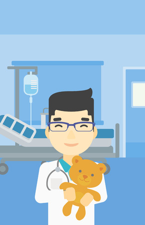 pediatrician: Young asian male pediatrician doctor holding a teddy bear. Professional pediatrician doctor with a teddy bear in the hospital room. Vector flat design illustration. Vertical layout.