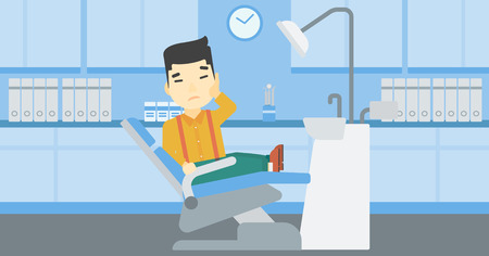 tooth pain: An asian young patient sitting in dental chair at dentist office. Sad man suffering from tooth pain. Man having a toothache. Vector flat design illustration. Horizontal layout.