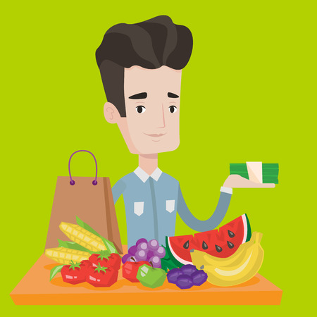 it is full: Young man standing at the table with shopping bag, fruits and vegetables on it. Shopper holding stack of money in hand in front of table full of food. Vector flat design illustration. Square layout.