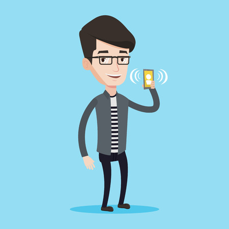answering: Young smiling man holding ringing mobile phone. Happy man answering a phone call. Man standing with ringing phone in hand. Vector flat design illustration isolated on blue background. Square layout.