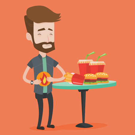 burn out: Hipster man suffering from heartburn. Man standing near the table with soda, french fries, hamburgers. Man touching his stomach with burning fire. Vector flat design illustration. Square layout.
