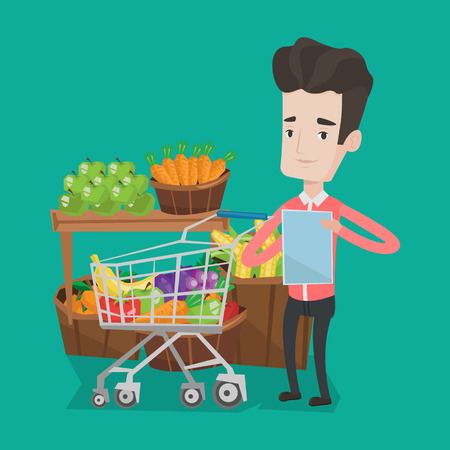 consumer goods: Young man standing near trolley full with products. Customer holding shopping list on the background of supermarket section with vegetables and fruits. Vector flat design illustration. Square layout.
