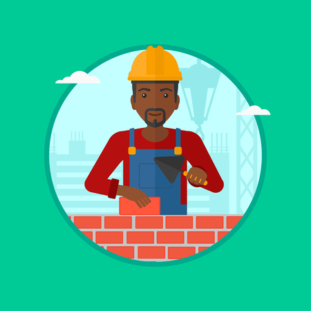 African-american bricklayer in uniform and hard hat. Bricklayer working with a spatula and a brick in hands on construction site. Vector flat design illustration in the circle isolated on background. Illustration