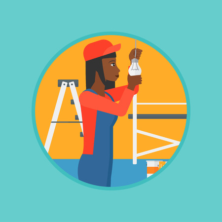 fixing: An african-american electrician twisting a light bulb. An electrician installing light in an apartment. Woman changing light bulb. Vector flat design illustration in the circle isolated on background. Illustration
