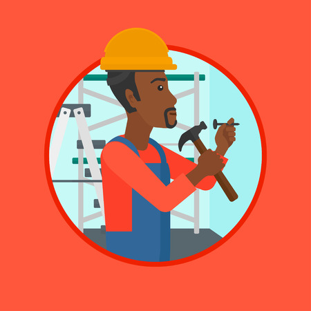 An african-american worker hammering a nail into the wall. Worker in overalls and hard hat nailing with hammer in apartment. Vector flat design illustration in the circle isolated on background.