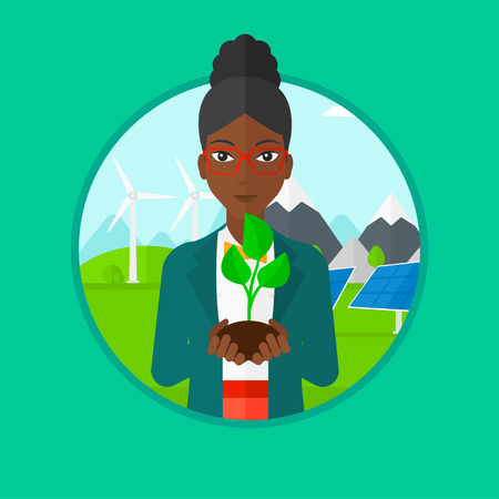 small plant: An african-american young woman holding in hands green small plant in soil on a background with solar pannels and wind turbins. Vector flat design illustration in the circle isolated on background. Illustration