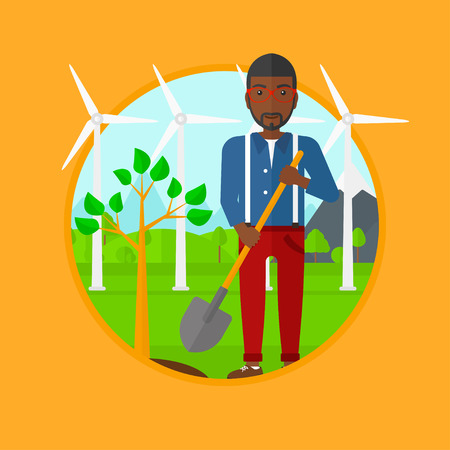 tree planting: An african-american young man standing with shovel near newly planted tree. Man planting tree on a background of wind turbines. Vector flat design illustration in the circle isolated on background.