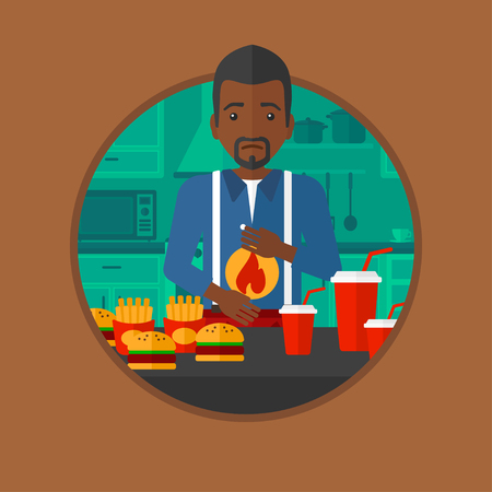 heartburn: An african man suffering from heartburn. Man standing in the kitchen in front of table with junk food and suffering from heartburn. Vector flat design illustration in the circle isolated on background