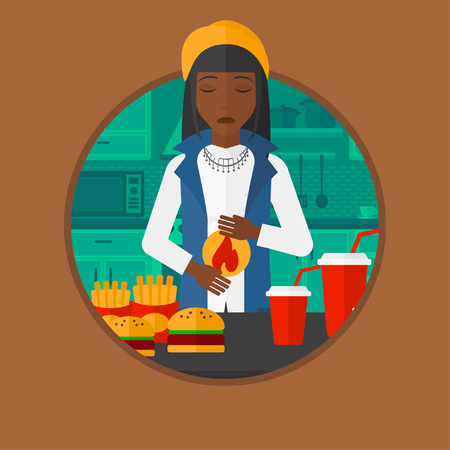 burn out: An african woman suffering from heartburn. Woman standing in kitchen in front of table with junk food and suffering from heartburn. Vector flat design illustration in the circle isolated on background