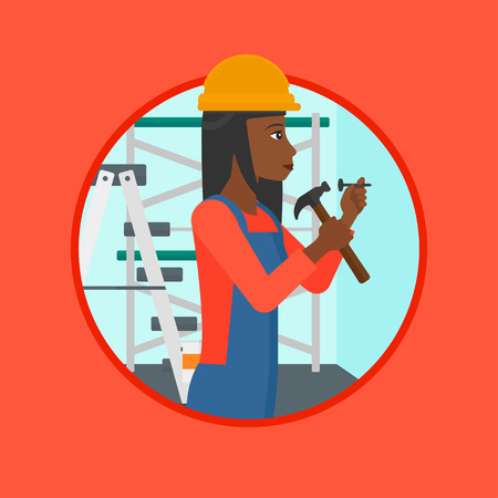 An african-american female worker hammering a nail into the wall. Worker in overalls and hard hat nailing with hammer in apartment. Vector flat design illustration in the circle isolated on background Иллюстрация