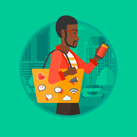 An african-american man walking with smartphone and handbag full of social media icons. Man using smartphone in the city street. Vector flat design illustration in the circle isolated on background.