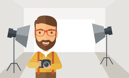 photography equipment: A Caucasian photographer smiling while inside the studio preparing the light and his camera to take a picture. A Contemporary style with pastel palette, soft grey tinted background.  flat design illustration. Horizontal layout. Stock Photo