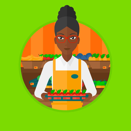 carrying box: An african-american supermarket worker holding a box with apples. Young supermarket worker carrying box with fruits in supermarket. Vector flat design illustration in the circle isolated on background