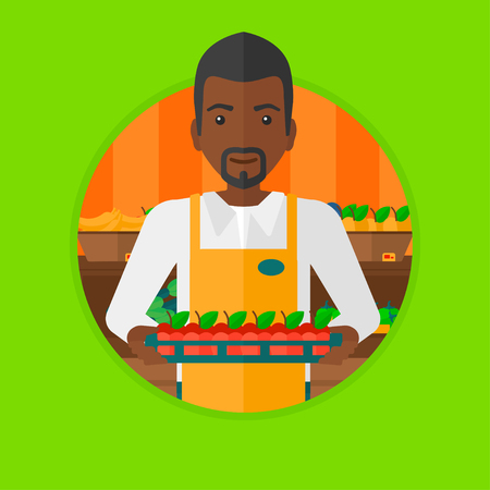 An african-american supermarket worker holding a box with apples. Supermarket worker carrying box with fruits in supermarket. Vector flat design illustration in the circle isolated on background. Vettoriali