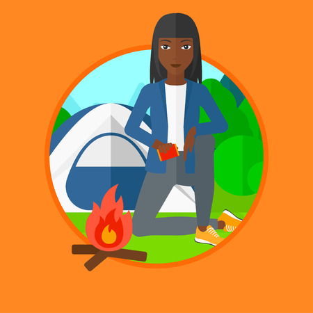 camping site: An african-american young woman kindling campfire on the background of camping site with tent. Tourist relaxing near campfire. Vector flat design illustration in the circle isolated on background. Illustration