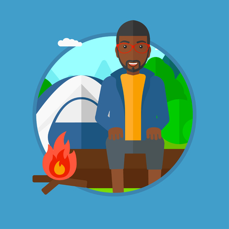 camping site: An african-american man sitting on a log near a fire on a background of camping site with tent. Tourist sitting near a campfire. Vector flat design illustration in the circle isolated on background.