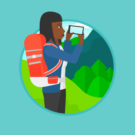 woman cellphone: An african-american woman taking photo of landscape with mountains. Young woman with backpack taking photo with her cellphone. Vector flat design illustration in the circle isolated on background.