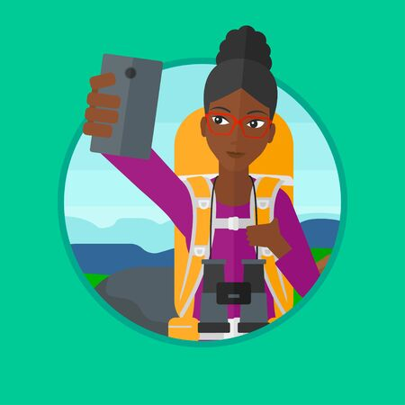 woman cellphone: An african-american woman making selfie on the background of hilly countryside. Woman with backpack taking photo with cellphone. Vector flat design illustration in the circle isolated on background.