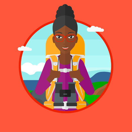 An african-american woman with backpack walking in the mountains. Young backpacker with binoculars. Traveler hiking in mountains. Vector flat design illustration in the circle isolated on background.
