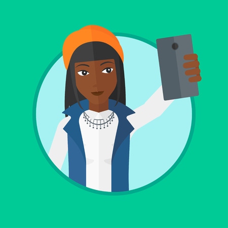 An african-american woman making selfie. Young woman taking photo with cellphone. Woman looking at smartphone and taking selfie. Vector flat design illustration in the circle isolated on background.