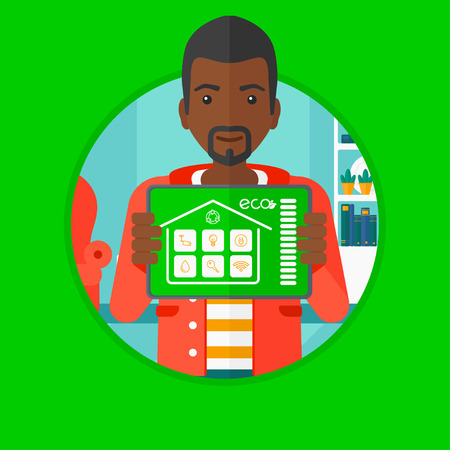 vector control illustration: An african man holding a tablet computer with remote home control system on a screen. Man showing tablet with smart home app. Vector flat design illustration in the circle isolated on background.