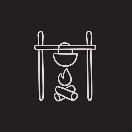Cooking in cauldron on campfire vector sketch icon isolated on background. Hand drawn Cooking in cauldron on campfire icon. Cooking in cauldron on campfire sketch icon for infographic, website or app.