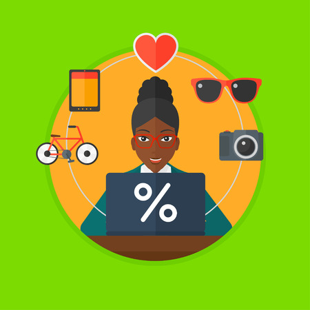 consumer goods: African-american woman using laptop and some images of goods around her. Woman doing online shopping. Woman buying on the internet. Vector flat design illustration in the circle isolated on background