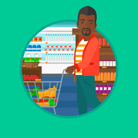 consumer goods: An african-american young man pushing a supermarket cart with some goods in it. Customer shopping at supermarket with cart. Vector flat design illustration in the circle isolated on background.
