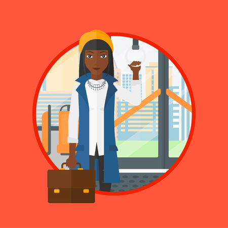 handgrip: An african woman traveling by public transport. Woman standing in a public transport. Woman traveling by passenger bus or subway. Vector flat design illustration in the circle isolated on background.
