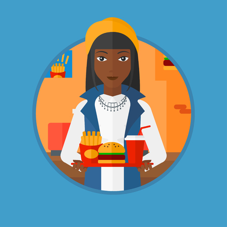 french ethnicity: An african woman holding tray full of junk food. Woman in fast food restaurant. Woman having lunch in a fast food restaurant. Vector flat design illustration in the circle isolated on background.