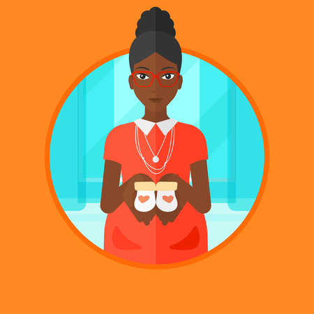 An african-american young pregnant woman holding baby booties in hands. Smiling pregnant woman holding baby booties on the belly. Vector flat design illustration in the circle isolated on background. Illustration