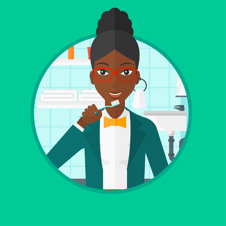 An african-american woman brushing her teeth with a toothbrush in bathroom. Smiling woman with toothbrush. Daily hygiene concept. Vector flat design illustration in the circle isolated on background. Stock fotó - 63813070