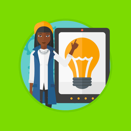 work addicted: African-american woman pointing at a big tablet computer. Woman standing near a big tablet computer with a light bulb on a screen. Vector flat design illustration in the circle isolated on background.