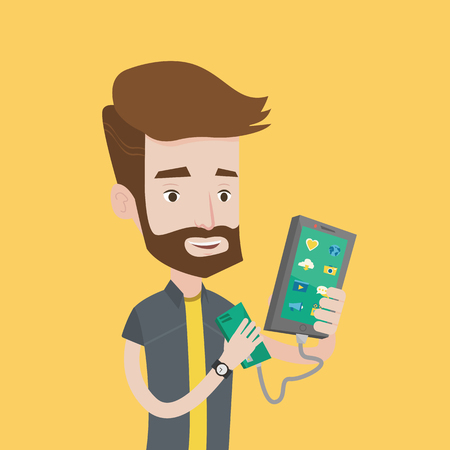recharging: Smiling hipster man with the beard recharging his smartphone with mobile phone portable battery. Young man holding a mobile phone and battery power bank. Vector flat design illustration. Square layout