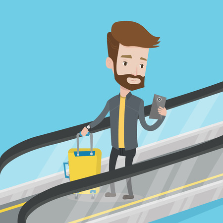 공항에서 에스컬레이터에 스마트 폰을 사용하는 사람 (남자). 휴대 전화에서 에스 컬 레이터에 서있는 사람을 여행 하 고 휴대 전화를 찾고. 에스컬레