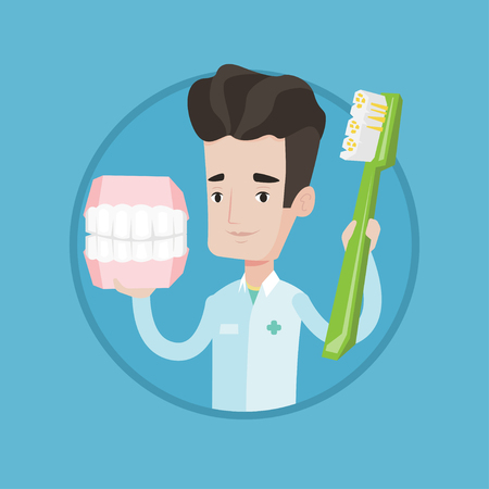 orthodontist: Young friendly dentist holding dental jaw model and a toothbrush in hands. Male dentist showing dental jaw model and toothbrush. Vector flat design illustration in the circle isolated on background.