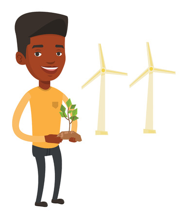 An african worker of wind farm. Man holding in hands green small plant in soil on the background of wind turbines. Green energy concept. Vector flat design illustration isolated on white background. Vettoriali