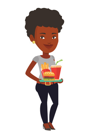 African-american young woman having a lunch in a fast food restaurant. Happy woman holding tray with fast food. Woman eating fast food. Vector flat design illustration isolated on white background.